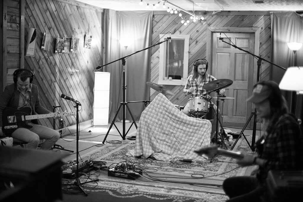 Musician plays in spacious recording studio in Nashville