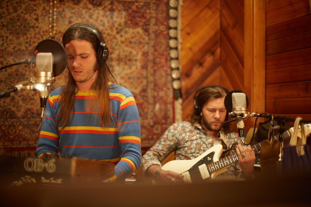 Musicians Recording in Studio Booth.